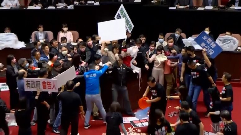 Punches, pig guts thrown in Taiwan's parliament 1