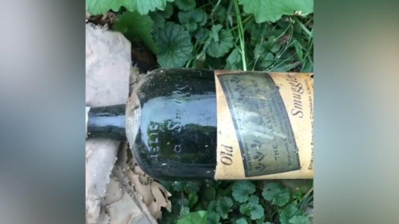 Couple finds prohibition-era booze hidden in walls 1