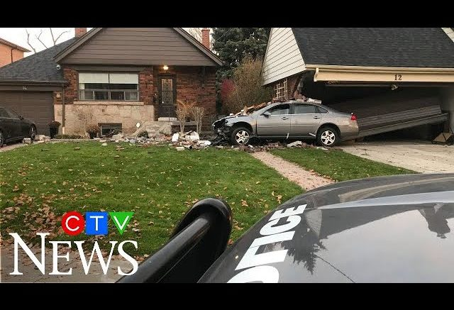 Car slams into Toronto home, teen arrested in connection 1