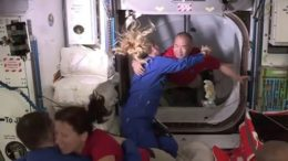 Astronauts aboard SpaceX capsule arrive at space station 2