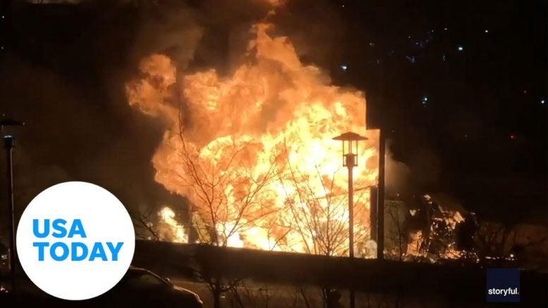 Truck carrying 300 propane tanks flipped and burst into flames in NY | USA TODAY 1