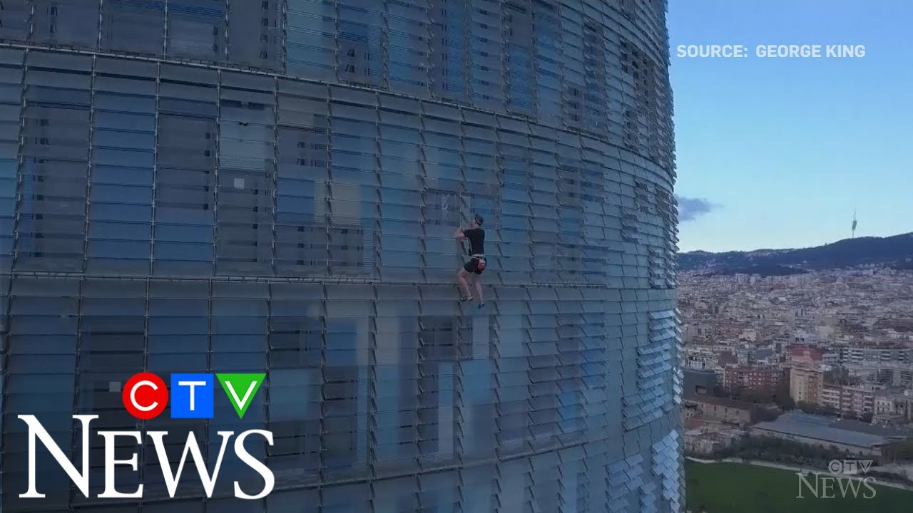 Extreme athlete climbs 33-storey building in Spain 1