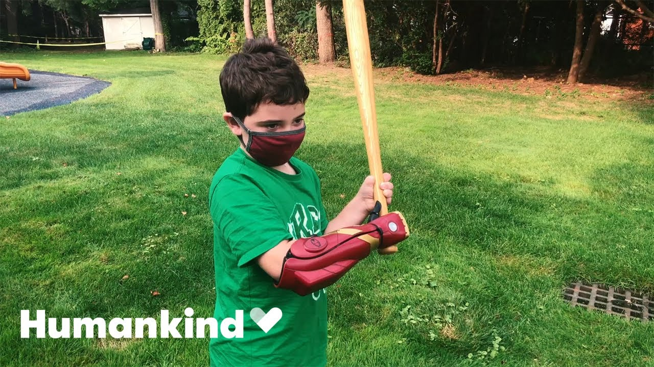 Eight-year-old tries on Iron Man prosthetic arm   Humankind 1