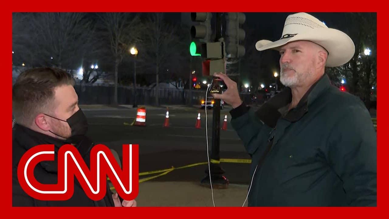 CNN reporter talks to Trump conspiracy theorist at Biden's inauguration 1