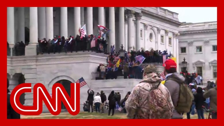Pro-Trump rioters storm US Capitol steps 1