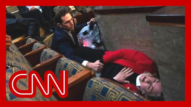 Lawmaker describes moment captured in dramatic photo 1