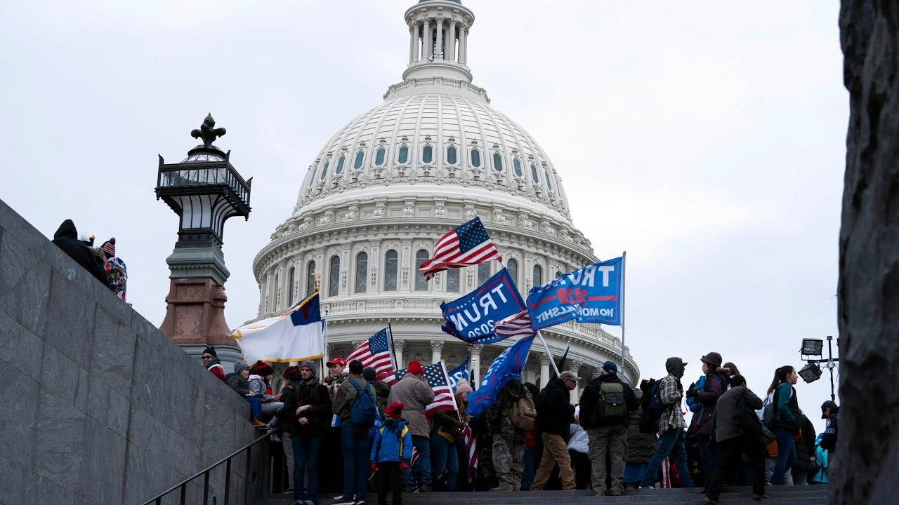 Watch pro-Trump supporters break barricades outside U.S. Capitol Building 1