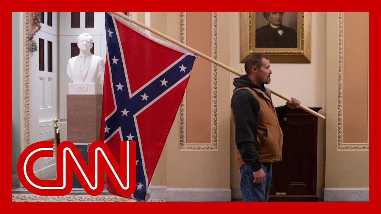Man with Confederate flag in Capitol identified and arrested 1