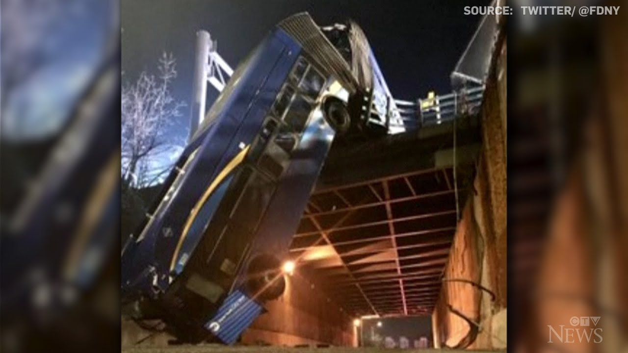 NYC bus dangles precariously from overpass after crash 1