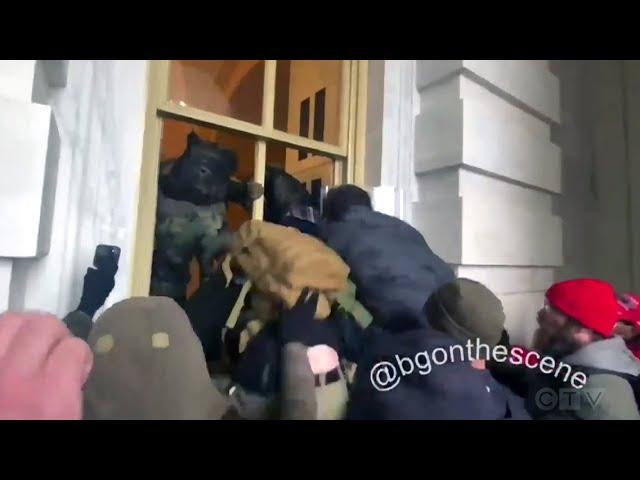 Trump supporters smash windows at U.S. Capitol building 1