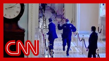 Jake Tapper reacts to video of officer rushing Mitt Romney to safety 6