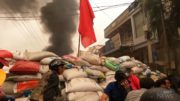 Myanmar protesters throw projectiles at security forces 4