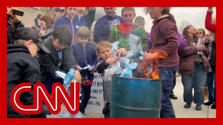 Children burn masks at rally 1