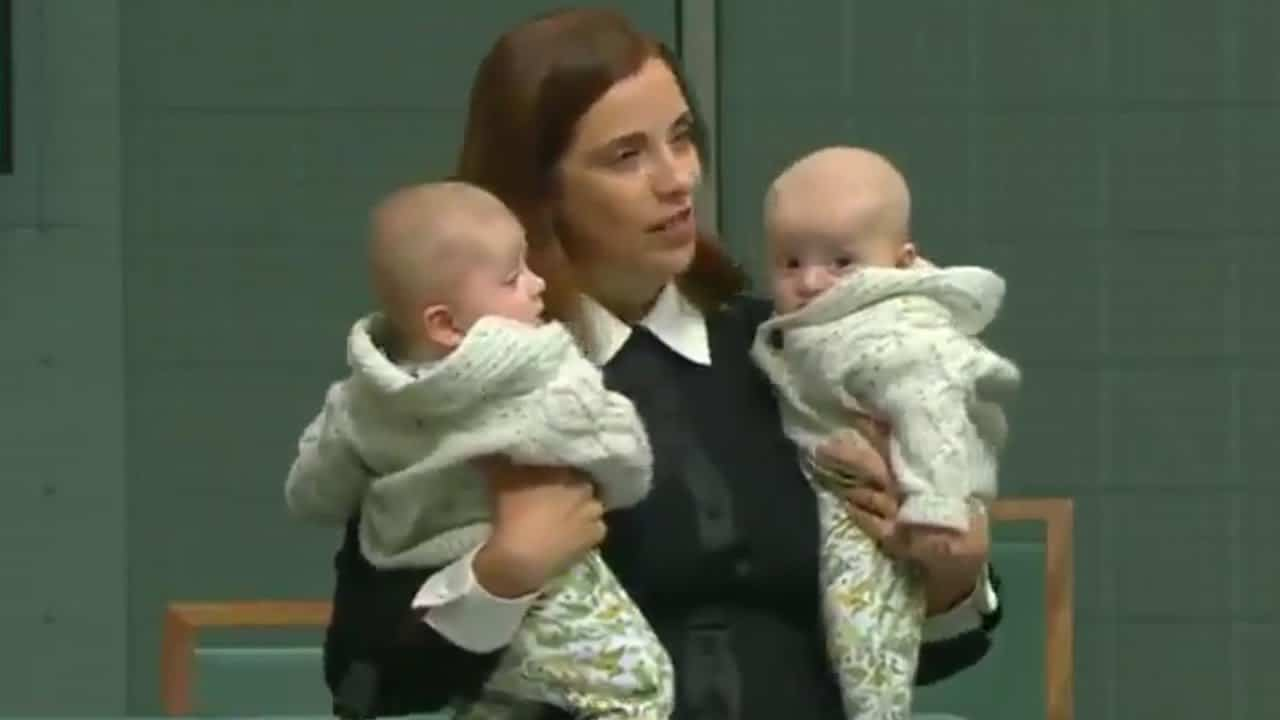 Australian holds twins while giving speech in parliament 6