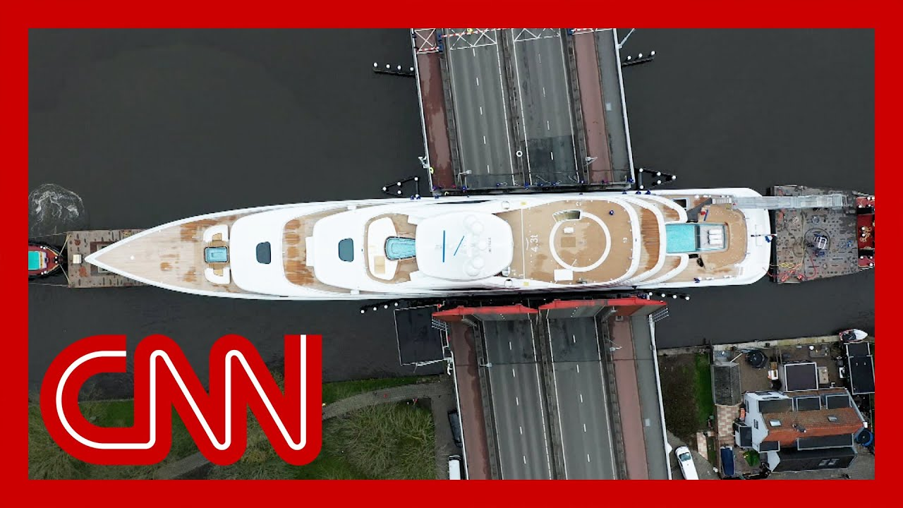 Huge superyacht squeezes through narrow canals 1
