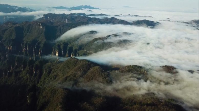 'Sea of clouds' form over scenic mountains in China 1