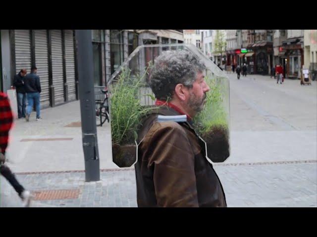 "A Belgian artist has designed a portable pandemic ""bubble"" made of a plexiglass plant pod. 1"