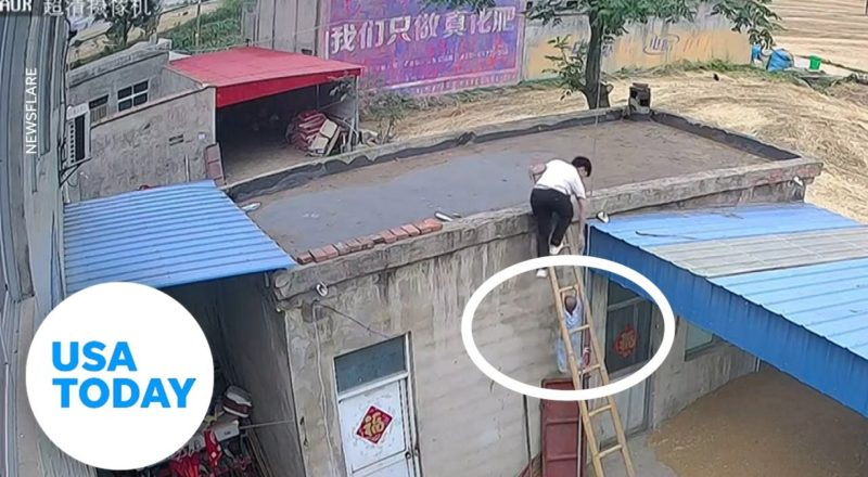 Toddler holds tightly to a ladder after attempting a terrifying climb | USA TODAY 1