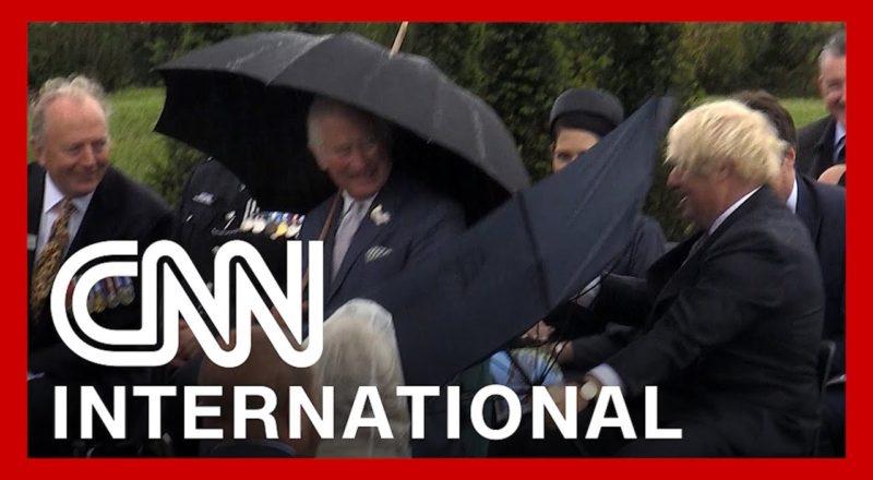 Boris Johnson's umbrella struggle makes Prince Charles laugh 1