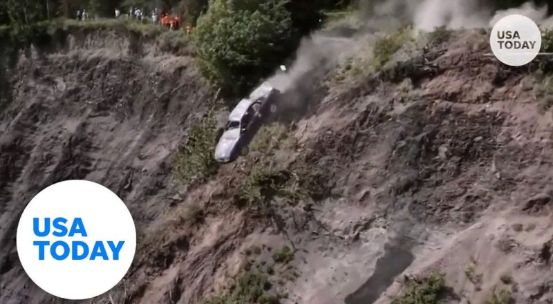 Cars launch off 300-foot cliff during Alaska town's annual tradition   USA TODAY 1