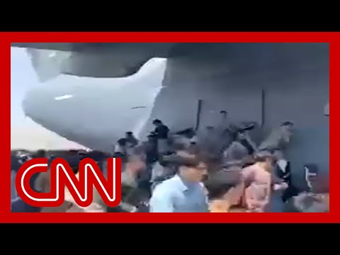 Chaos at the airport as Afghans try to flee the Taliban 8