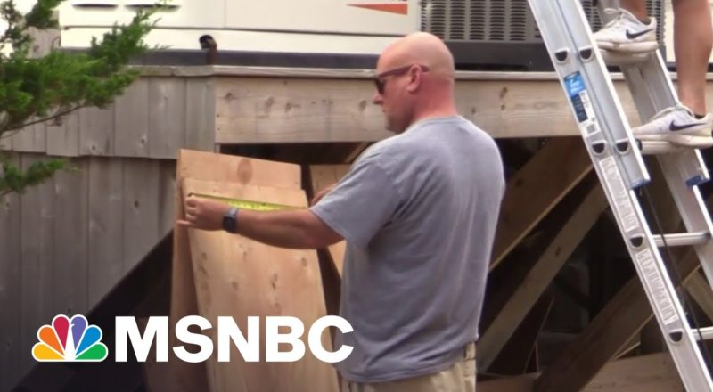 East Coast Shorelines Board Up Storefronts, Homes In Preparation For Tropical Storm Henri 1
